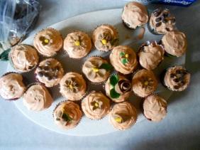 Two dozen cupcakes, one rose.