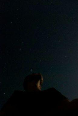 At the stars.