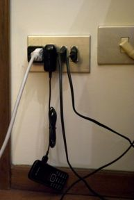 Converting electricity and charging foreign cell phones.