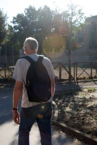 The famed professor Jan Gadeyne leads a pack of about 40 students around the ancient Aurelian wall of Rome.