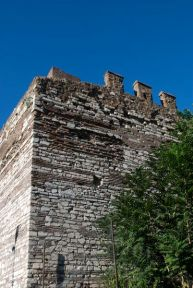 This piece of wall shows evidence of having been rebuilt in the middle ages due to its patchwork of brick.
