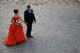 There may be many weddings tonight, but there's only one bright red bride!