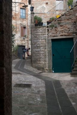 Kyle ties his shoes and shows the scale of this steep, narrow street.
