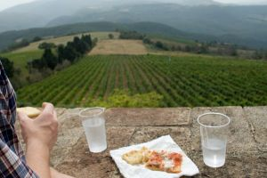 Enjoying antipasti pizza and sparkling mineral water over the Umbrian landscape.