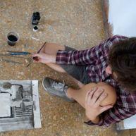 Alexis paints Kyle.
