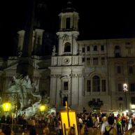 Piazza Navona is very busy at night.