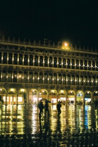 Piazza San Marco at night in the rain.
