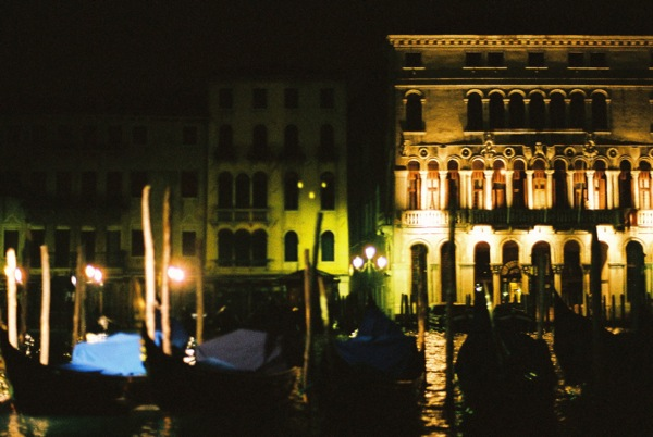 The canals sit still in the wee hours of the morning in Venice.