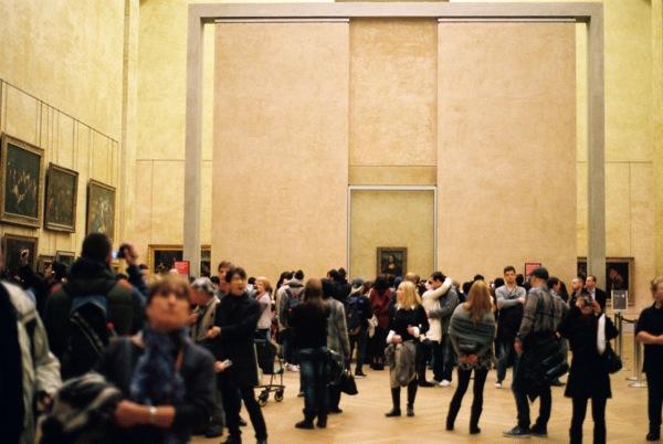 People, people, bullet proof glass, flash photography, Mona Lisa.