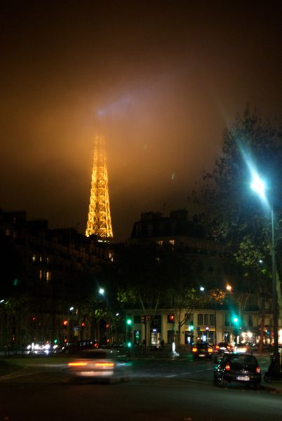 The tip of the Eiffel Tower is erased by the Paris fog.