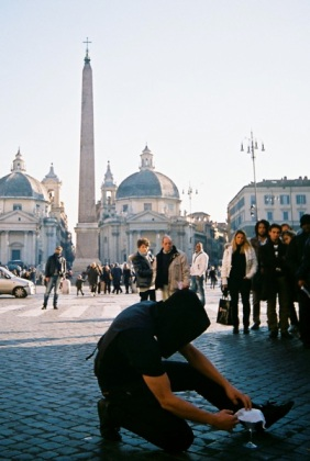 The hooded magician at Piazza del Popolo.