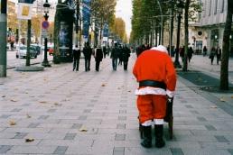 Santa walks down Champs-Élysées.