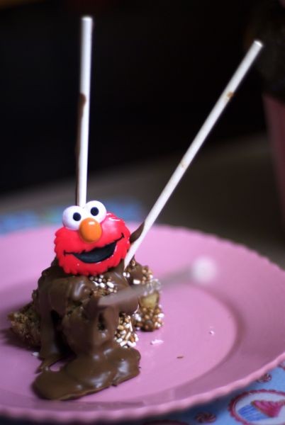 Surprise! The cake pop exploded and Elmo is here!