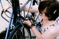 Brittany and her bike tying.