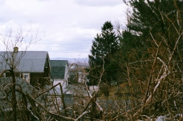An old mine town: house smushed together, and everything's dead.