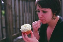 Melissa savors the white chocolate shavings from her pristine cupcake.