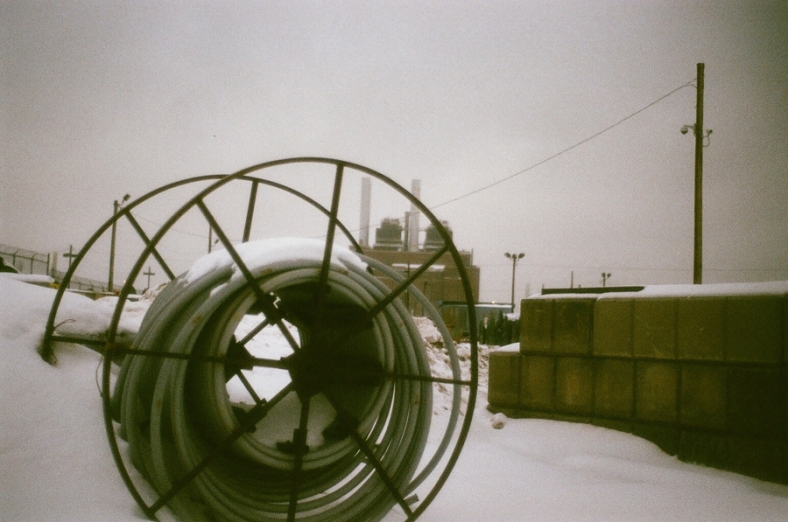 Through the spool.