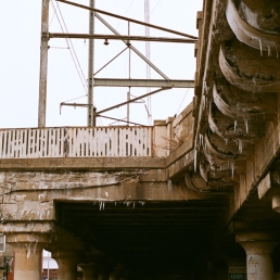 Under the dripping overpass.