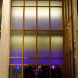 A purple glow emanates from the Barnes Foundation on Young Professionals Night.