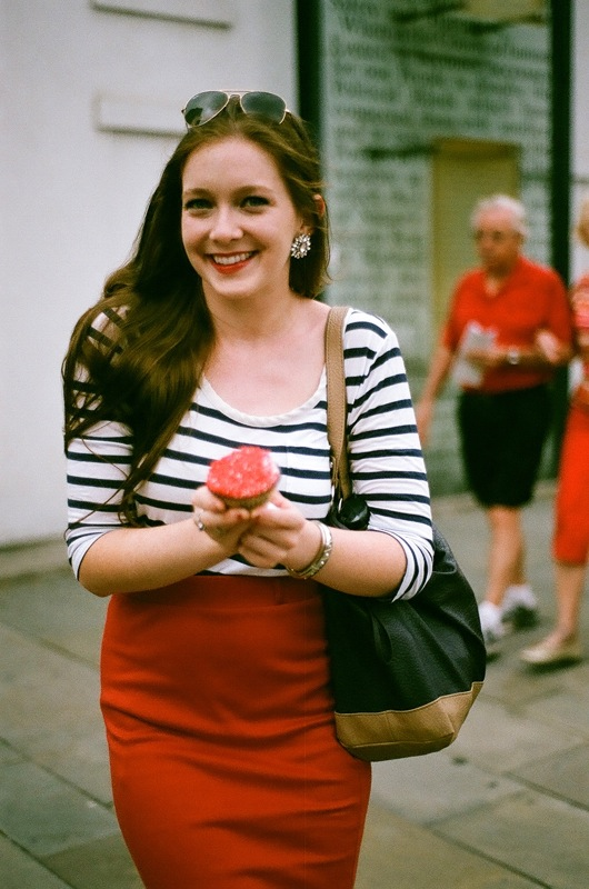 "Katie Grace hails us on the corner, ""I'm wearing red, white, and blue!"" You and everyone else, Katie."