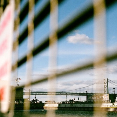 The Benjamin Franklin Bridge as seen through the hammock cage at Spruce Street Harbor Park.