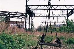 A swing hangs from the viaduct.