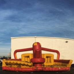 A deflated, defeated bounce house behind That Bounce Place, Wilkes-Barre, PA.