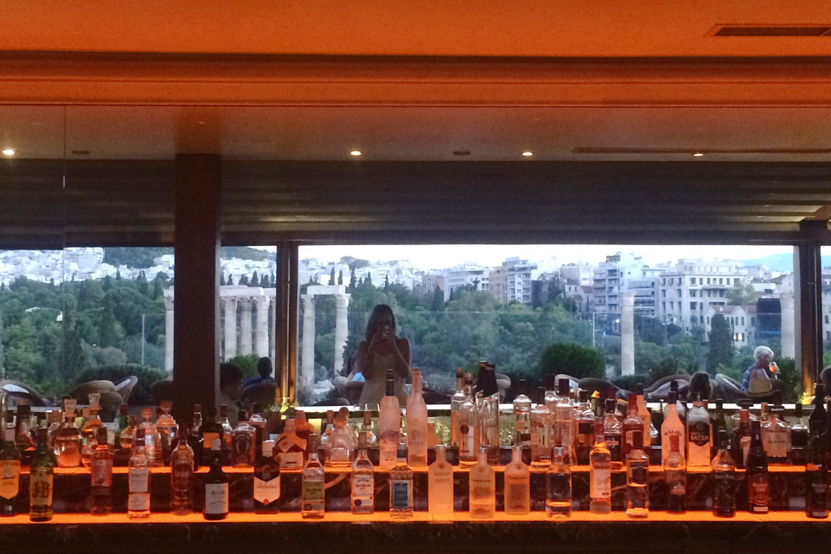 A full bar with a reflection of the beautiful view.
