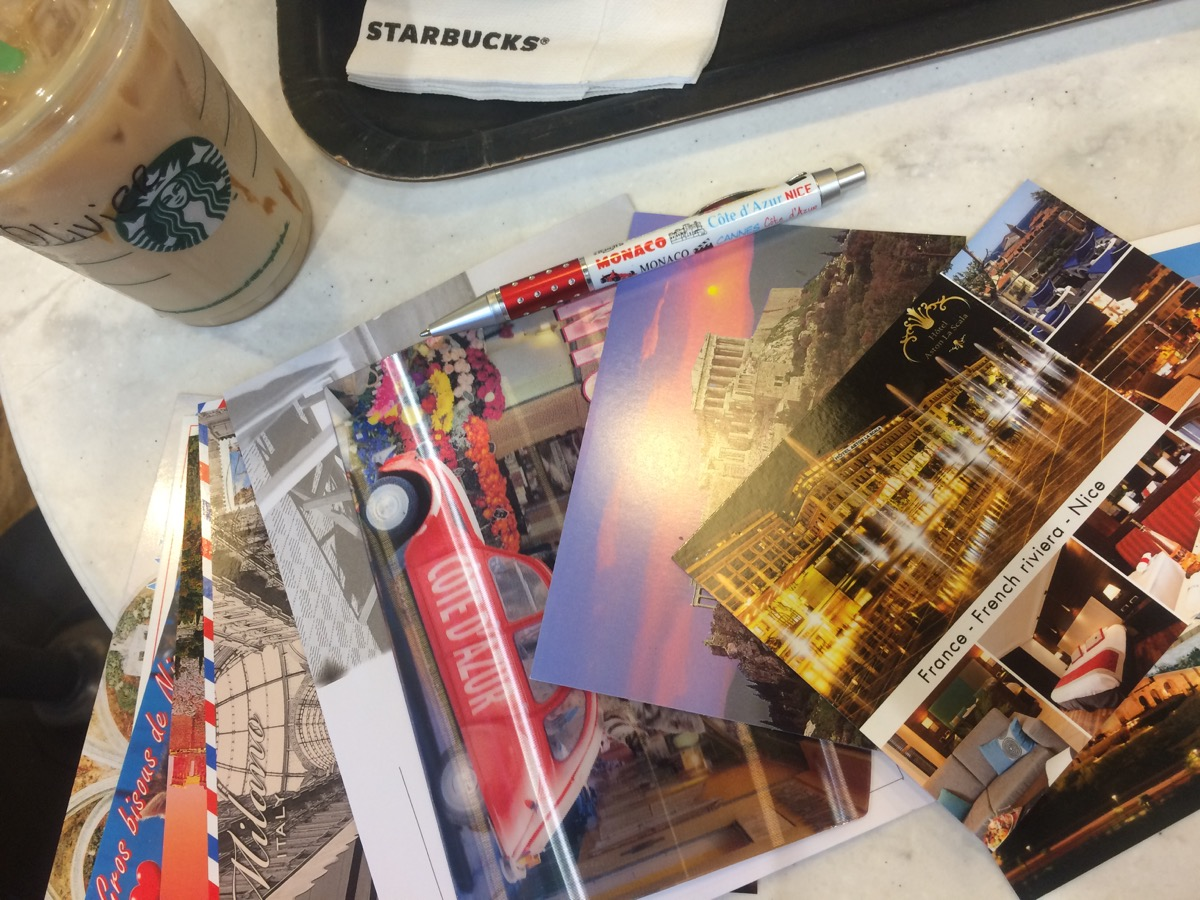 Postcard writing from Starbucks in Nice.